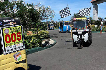 Rickshaw Challenge Deccan Odyssey tuk tuk race in India start checkered flag