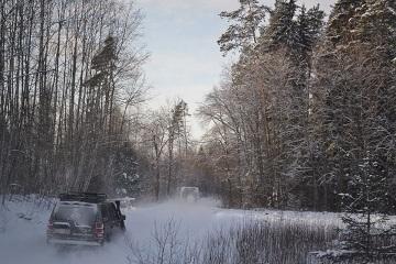 Winter forest driving Baltic Run snowy adventure